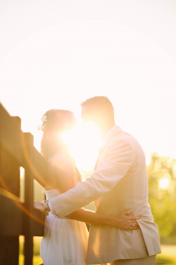 50 Bride and groom kissing with sun light shining through at  Lindsey Plantation in Greer SC wedding