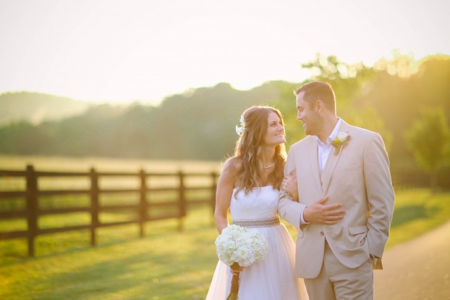 51 bride and groom walking arm and arm down road at  Lindsey Plantation in Greer SC wedding