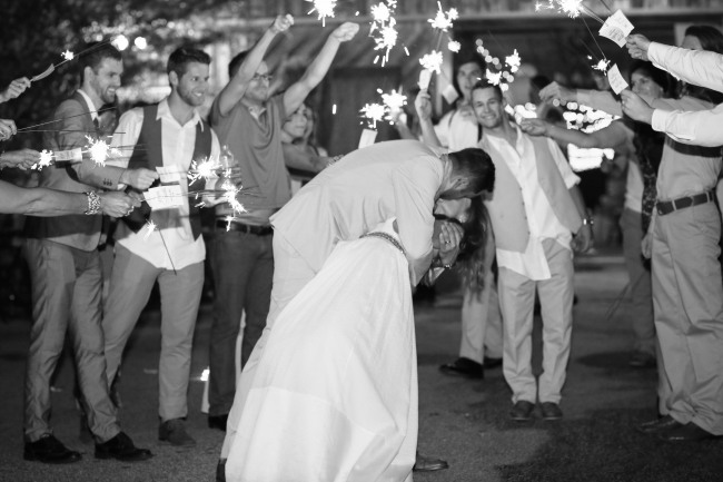 60 groom kissing bride with sparkler send off at  Lindsey Plantation in Greer SC weddig