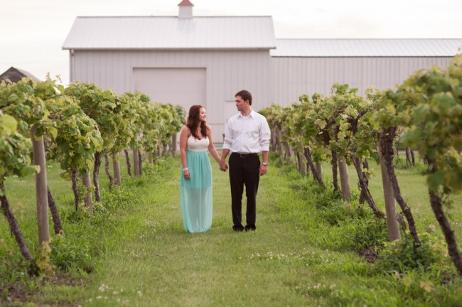 8 DAVENPORT WINERY engagement shoot couple walking up vinyard row