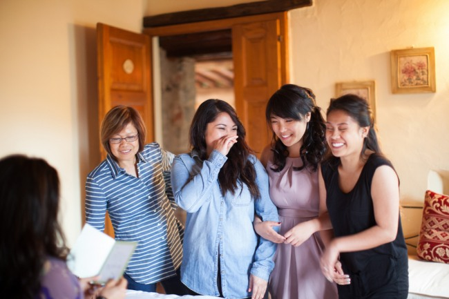8 bride reading letting to her family while getting ready at Livernano Radda in Chianti Tuscany, Italy wedding