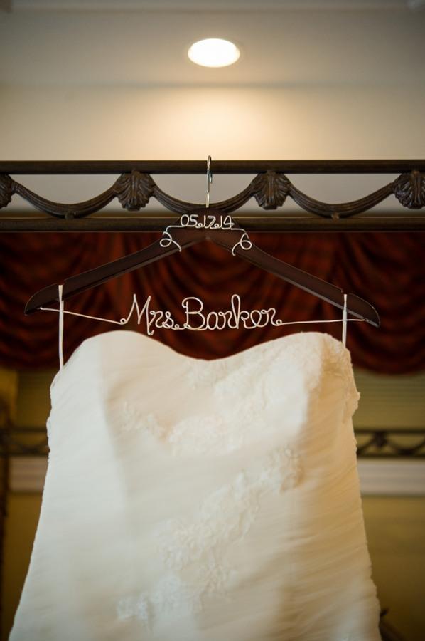 "bridal dress hanging on custom ""word hanger"" with bride's name"