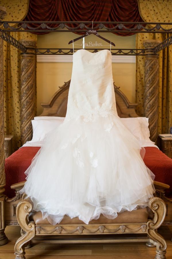 bride's dress hanging in bridal chamber at Benton Grove Bed & Banquets