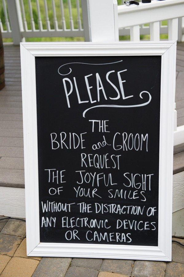 Chalkboard sign requesting guests to turn off electronic devices
