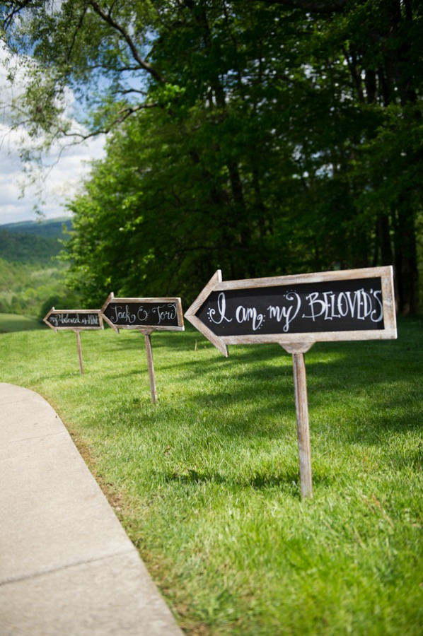 chalkboard arrow sign stakes in grass