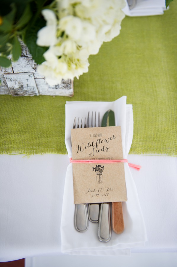 Cutlery wrapped with wildflower seeds guest favor