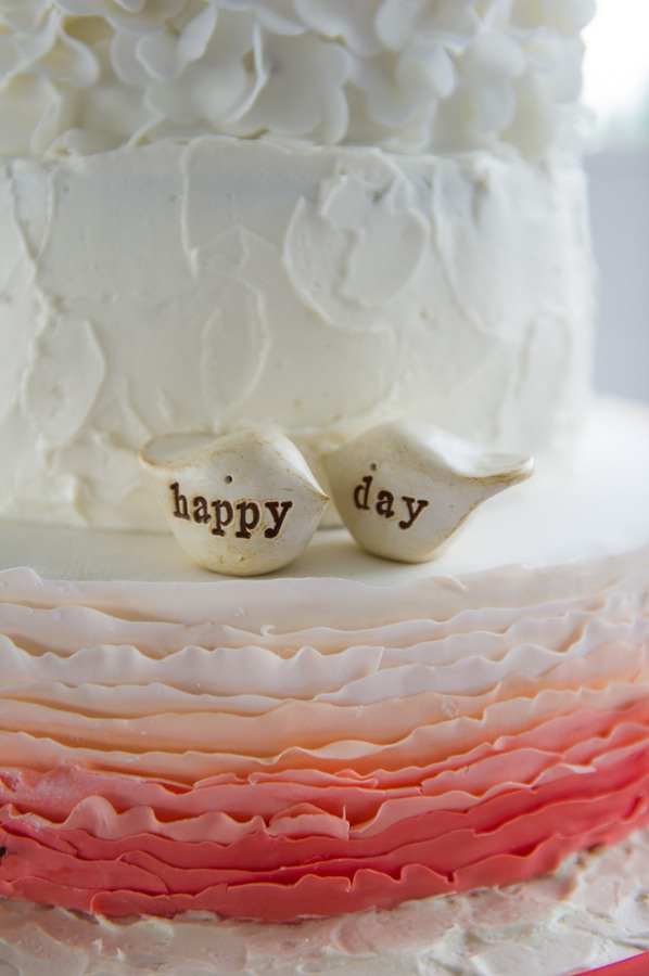 figurines on white wedding cake