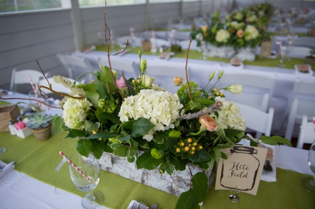 white hydrangea centerpiece on lime green table runner