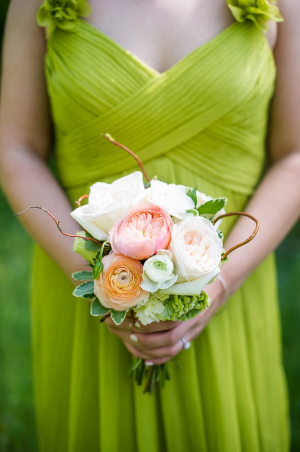 lime green bridesmaid dress with bouquet of white peonies, succulents, Juliet roses, eucalyptus, white ranunculas, and hypericum berries