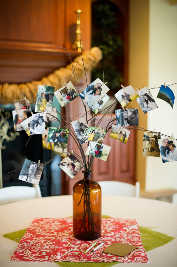 photos on tree branches in bottle