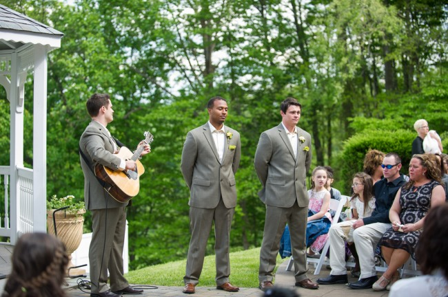 Groomsmen with guitarist at front during wedding ceremony