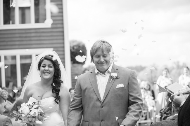 black and white photo of recessional with flower petals
