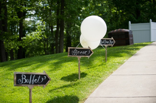 arrow signs with white geronimo balloons on grass