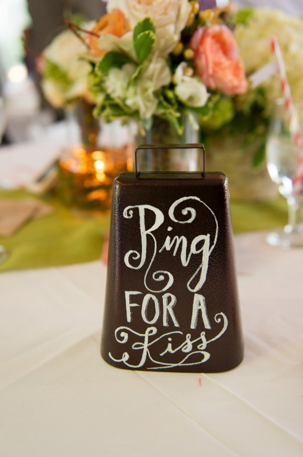 """cowbell painted with words, """"Ring for a kiss"""""""