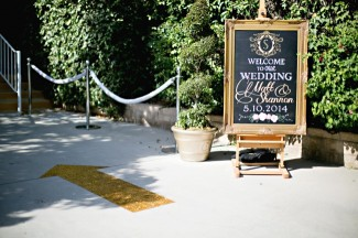 chalkboard with gold frame and personal wedding logo