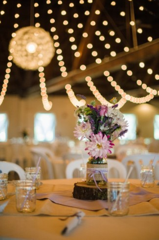 11 Green Villa Barn & Gardens, Oregon wedding reception table center piece flower arrangement on a piece of cut wood