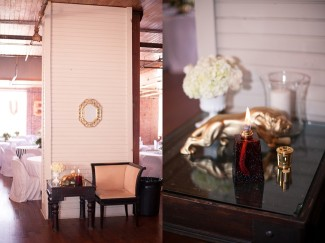 14 lounge area for wedding guests at reception with candle and gold frame and gold lion and white hydrageas