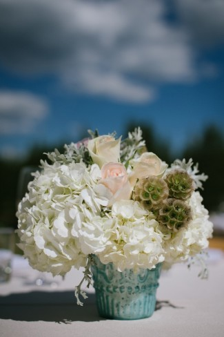 outdoor wedding reception at PJ's Bar and Grill, center pieces with while hydragiea and green and peach flowers