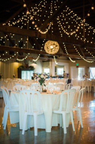 16 Green Villa Barn & Gardens, Oregon wedding reception with white3 light hanging from ceiling