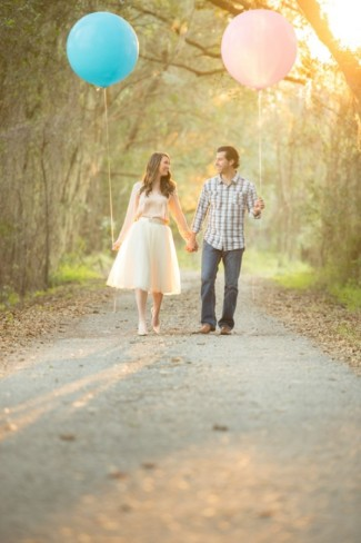 17 3 Maternity photo couple standing on path holding pink and blue geronimo balloons