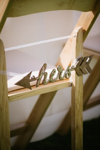 17 ourdoor wedding reception in Sierra Nevada mountains brides chair with a her sparkly arrow