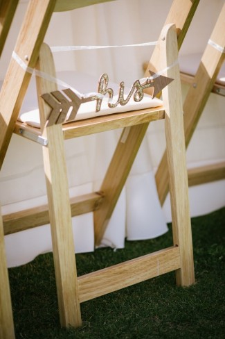 17 ourdoor wedding reception in Sierra Nevada mountains grooms chair with a his sparkly arrow