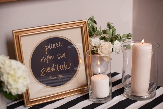 17 wedding guest book table with gold frame and white candles