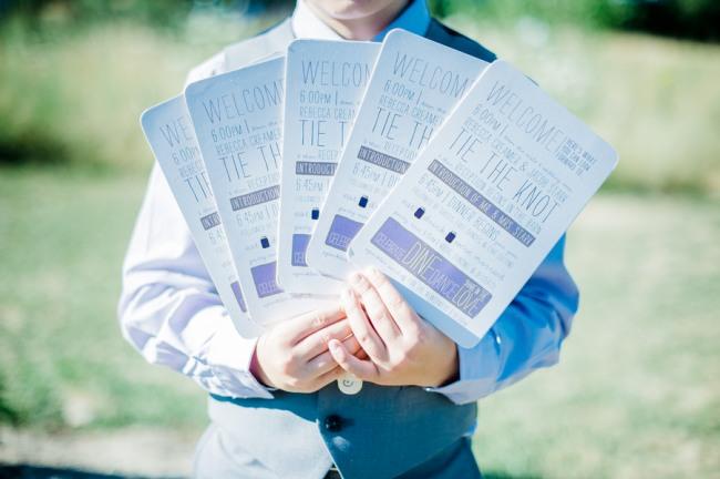 Purple wedding ceremony program fans at Green Villa Barn & Gardens, Oregon