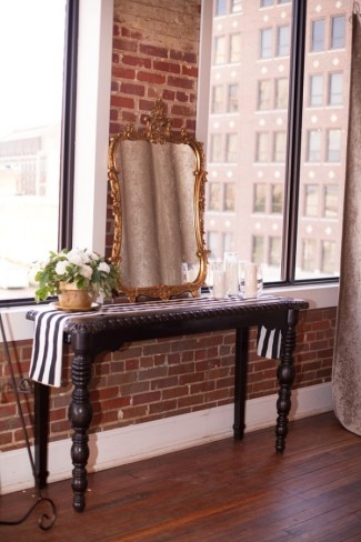 DIY wedding at Aubrey Hall reception table with gold mirror and black and white striped table runner