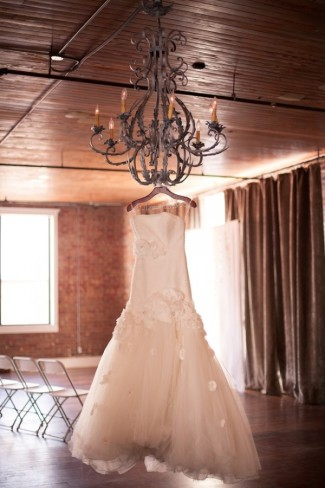Wedding dress hanging from Chandelier at Aubrey Hall