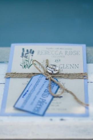 Lavender and purple themed wedding invitation with diamond engagament ring at Green Villa Barn & Gardens