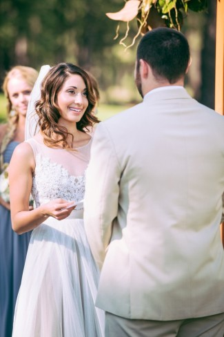 outdoor wedding ceremony in Sierra Nevada mountains brides reading vow to groom