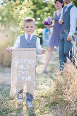 Green Villa Barn & Gardens wedding ceremony with ring bearer holding a burlap sign forever and ever amen