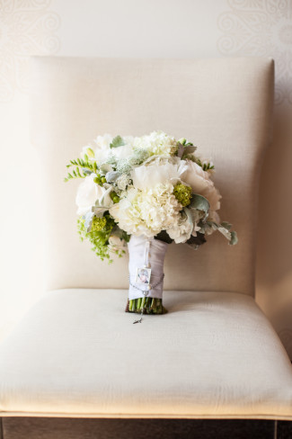 White bridal bouquet sitting on white chair at Guglielmo Winery wedding in California