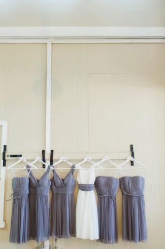 Purple bridesmaids dresses hanging at Green Villa Barn & Gardens wedding