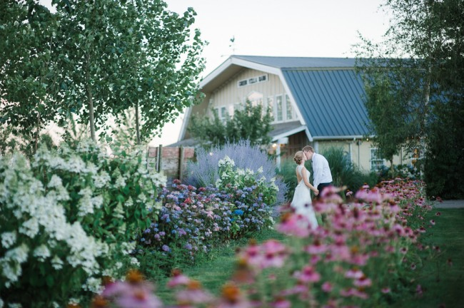 31 Green Villa Barn & Gardens, Oregon bride and groom shot out in the garden with flowers
