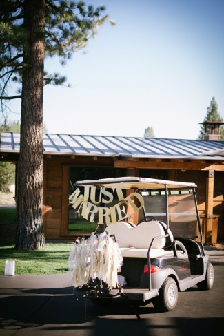 Gold just married sign on golf cart at Wedding with Pine Cone Details in Lake Tahoe