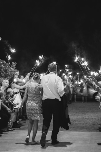black and white photo of bride and groom grand exit with sparklers