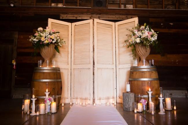 shutter screen backdrop with wine barrels in front for Guglielmo Winery wedding