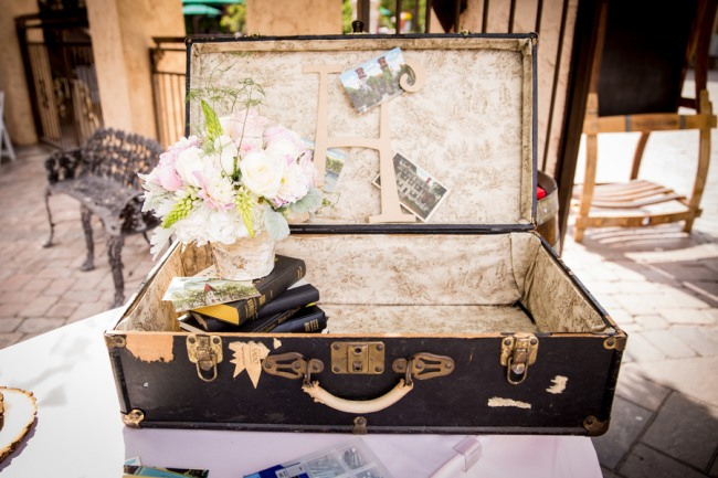 Vintage trunk opened with books and flowers inside