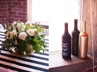6 Gold and black bottle, black and white striped table cloth and flower arrangement
