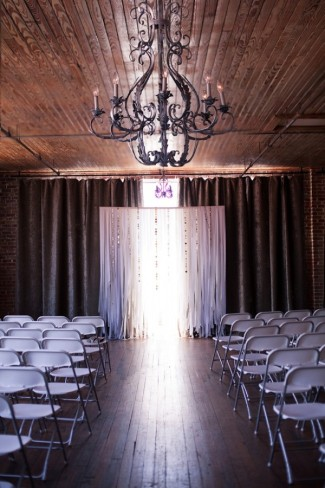 7 wedding ceremony with chairs and black rod iron chandalier