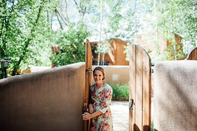 New Mexico mountaing wedding - Bride wearing floral satin robe before getting ready