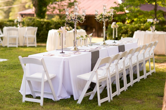 elegant garden party wedding reception with grey table runner, outdoors at the reserve at oak bowery