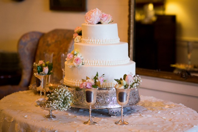 Elegant garden party wedding cake on silver cake stand from Sonshine Cakes