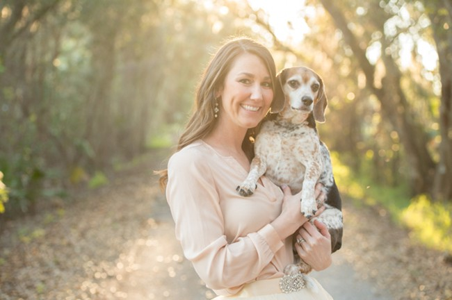 Pregnancy photo shoot mother-to-be with beagle dog