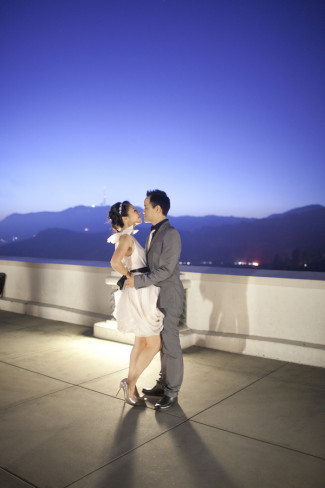 Couple embraces during Chic Observatory Engagement Shoot