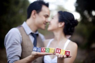 engagment shoot couple holding colored wooden blocks 2 of 2