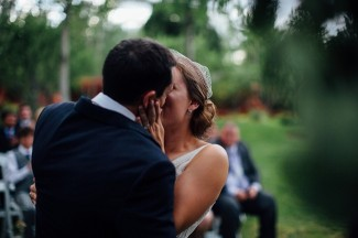 bride and grooms first kiss after wedding ceremomy