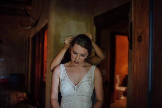 bride putting in her birdcarge veil